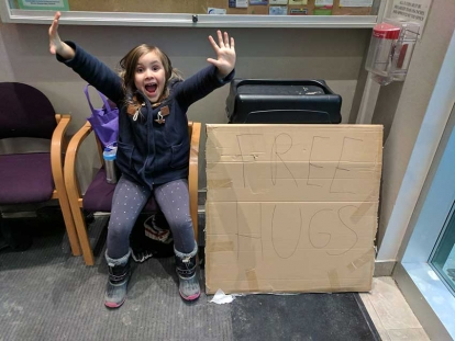 My daughter, Elizabeth, offering free hugs at the Pickering Islamic Centre on January 30, 2017.