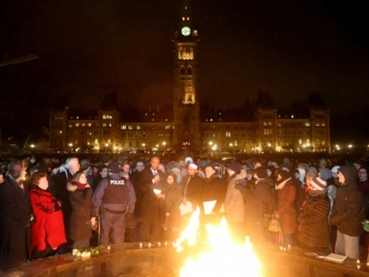 Members of Parliament gather with community members at the 2018 vigil after the one year anniversary of the Quebec Mosque Shooting.