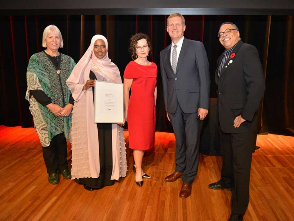 Rowda Mohamud won the inaugural Ross and Davis Mitchell Prize for Faith and Writing in October. Left to Right: Deborah Bowen (poetry judge), Rowda Mohamud, Davis Mitchell (Prize Sponsor), Michael Van Pelt (Cardus), and George Elliott Clarke (Canadian Parliamentary Poet Laureate)