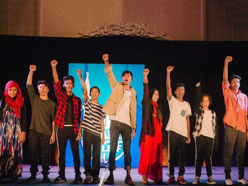A scene from the play I Am Rohingya performed by Rohingya refugee youth in Kitchener, ON and directed by Yusuf Zine.