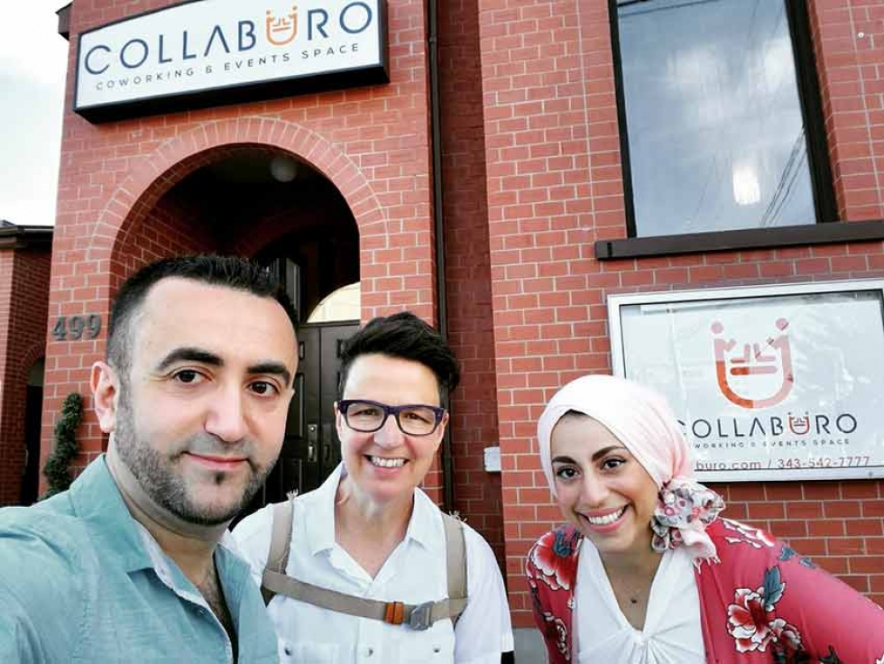 Collaburo co-owners Mohammad and Hanan take a selfie with their local city councillor, Catherine McKenney, in front of the new Events and Coworking space.