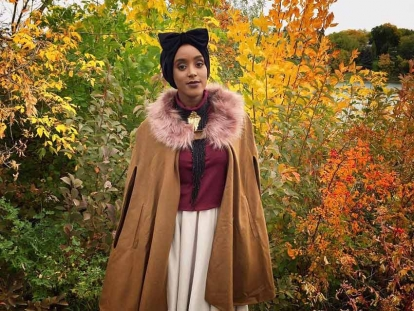 Fashion designer Eman Idil Bare is headed to New York Fashion Week. In this photo, she sports a handmade velvet turban and cape from her own fashion line
