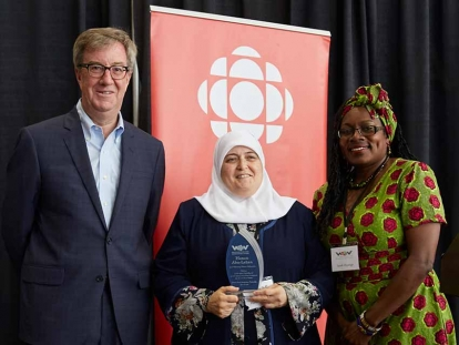 Hanan Abu Laban receiving her award with Mayor Jim Watson and Welcoming Ottawa Week Chair Sarah Onyango