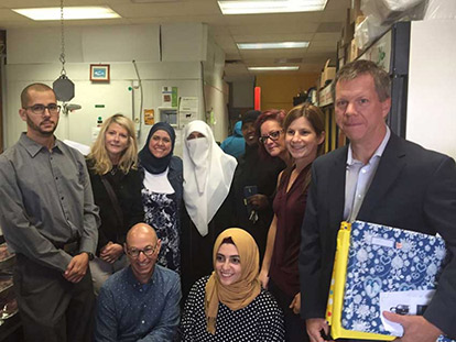 Members of the team that brought a special Eid al Adha to Muslim children in care this year. From left to right: Karim Mekki, Debbie Hoffman, Sawsane El Khatib, Majeda Elghaben, Aaminah Abdulqadir, Marion Bailey-Canham, Cindy Perron, Walter Noble, bottom row André Fontaine,  Ithar Abusheikha