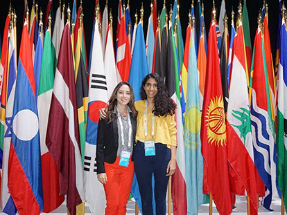 Dhilal Alhaboob (in yellow), with friend Yumun Sisalem, another Canadian Young One World Ambassador from Ottawa.