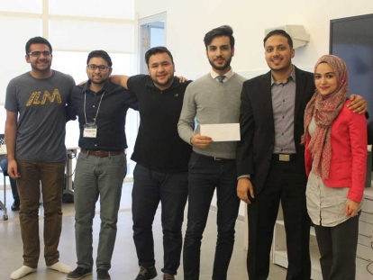Davoud Sarfaraz (holding the envelope) and his team members won first prize at ILM Weekend for their product SeerahBOX.