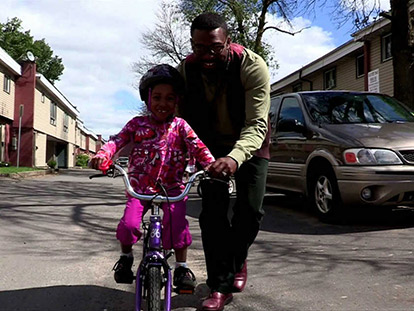 Jamal Rogers and his daughter HUSNIYAH, taken from the video of the same name.