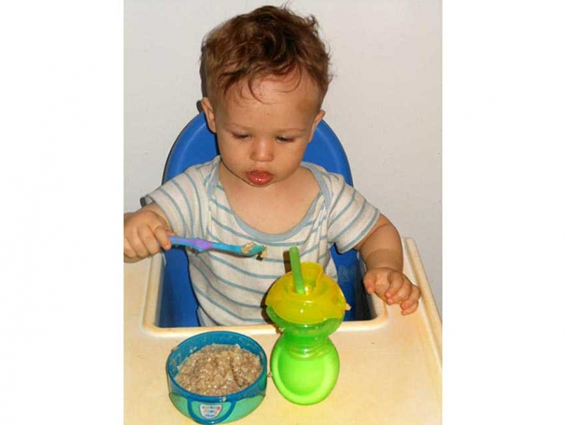 Baby Dean learns high-chair table manners.