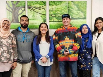 Healers Beyond Borders visit to Grassy Narrows. Mehreen Nasser is second from the right in blue. To her right is Jason Fobister of the Grassy Narrows First Nation.