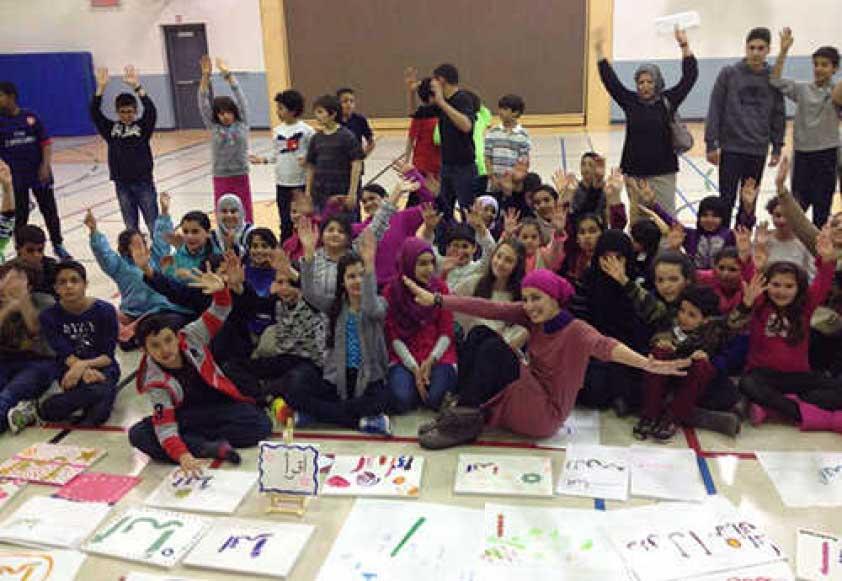 Nagat Bahumaid with Iqraa School students