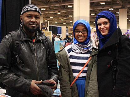 Bashir Mustafa and Zoulfira Miniakhmetova with their daughter at the 2014 Reviving the Islamic Spirit Conference.