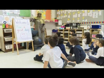 English Montreal School Board (EMSB) teacher Haniyfa Scott gives a lesson to her kindergarten class in April 2019. The EMSB is challenging the CAQ government's secularism law, which bars newly hired teachers and school administrators from wearing a hijab or any other religious symbol.