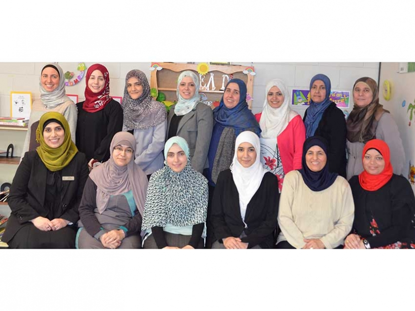 Dina Shalabi with Abraar School Arabic teachers and conference organizers.