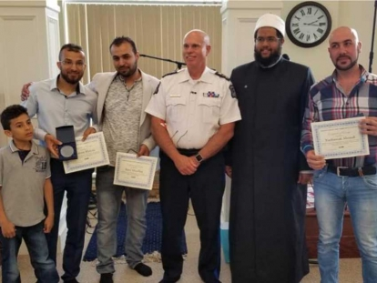 Nashwan Ahmed, Ibrahim Manna, and Raed Abualhaj with Halifax Police Chief Jean-Michel Blais and Imam Abdallah Yousri