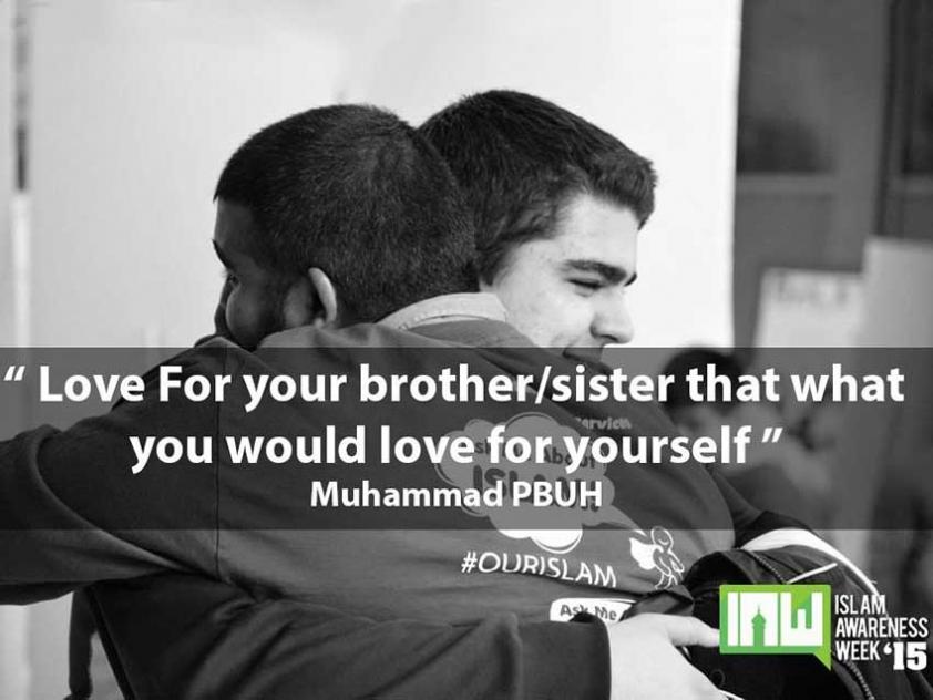 Two students hug at this year's Islam Awareness Week at Carleton University