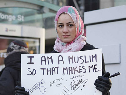 "Assma Galuta aka Asoomii Jay on the streets of Toronto during the filming of the video ""I Am A Muslim"""