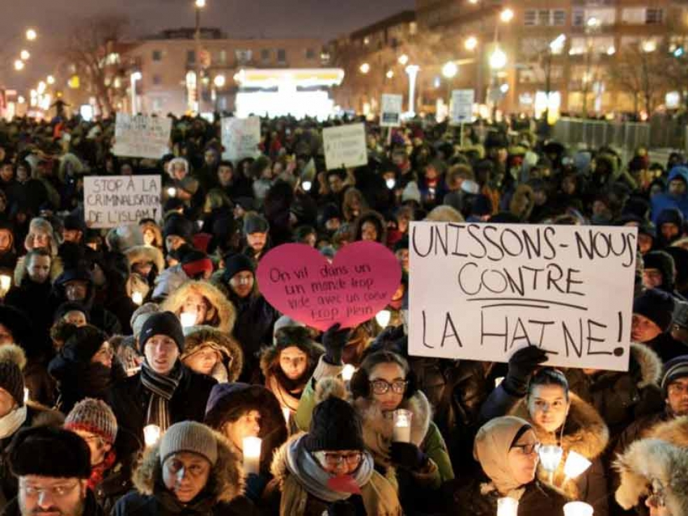 Mourners gather at a vigil in Quebec City in 2017 after the shooting at Centre Culturel Islamique de Québec