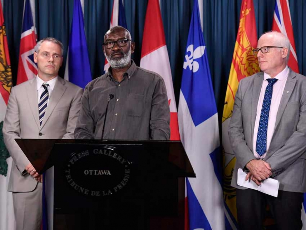 Sudanese Canadian Abousfian Abdelrazik at a press conference with his lawyer Paul Champ and Amnesty International Secretary General Alex Neve in September 2018.