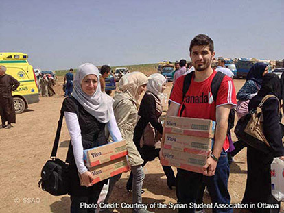 Rama Imadi and Yaman Marwah deliver supplies in Syria.