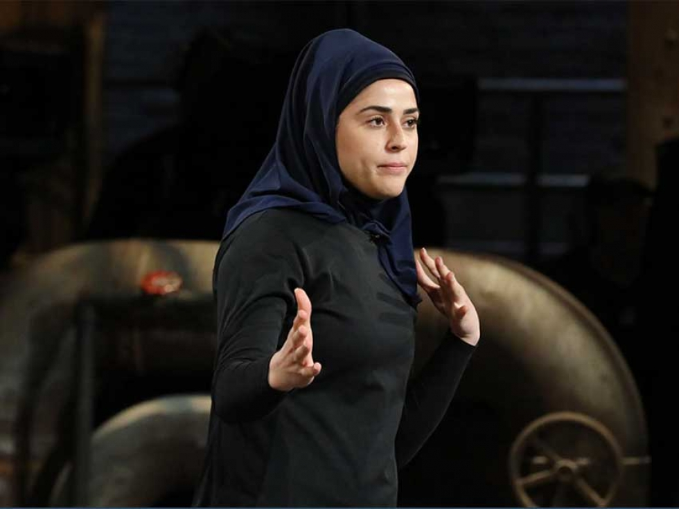 """Thawrih co-founder Sarah Abood demonstrates her product, the  """"quick release"""" hijab ideal for members of law enforcement."""