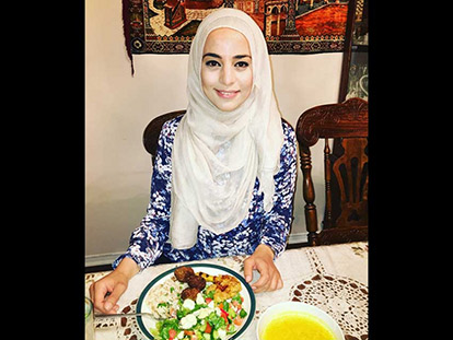 Registered dietitian Rawan Suleiman eating a healthy traditional Palestinian iftar meal.