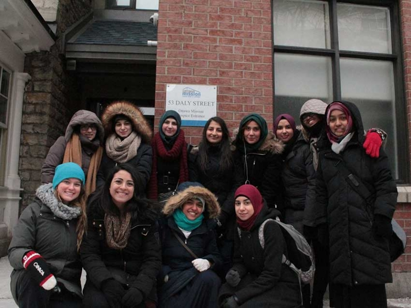 Members of Sunni and Shia Muslim students associations work together to help out the homeless.