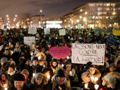 Here people attend a Montréal vigil for the Québec City victims on January 30, 2017