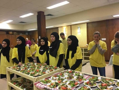 Members of the Ahlul Bayt Students Association (ABSA) and Christian students from the University of Ottawa team up to volunteer at Parkdale United Church.