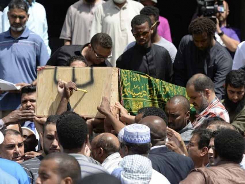 Mourners carry Abdirahman Abdi at his janazah (funeral) at the Ottawa Muslim Association in 2016.