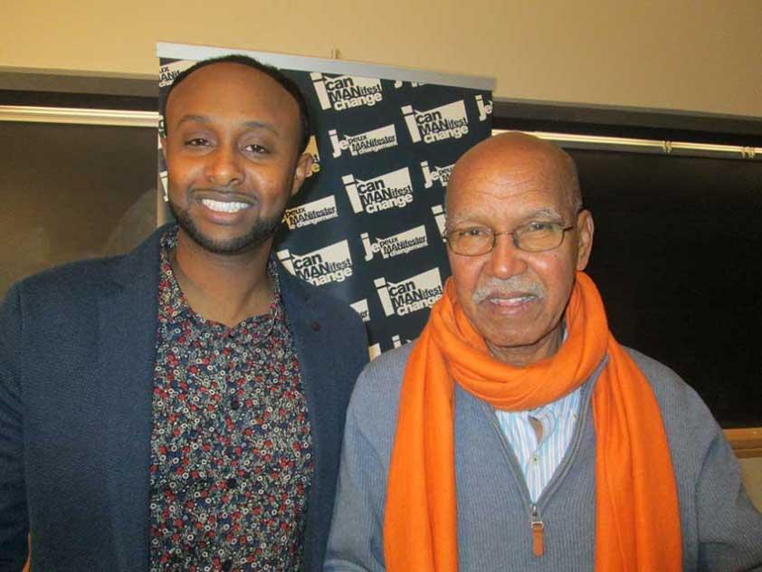 Crime Prevention Ottawa's Sharmaarke Abdullahi with novelist Nuruddin Farah, sporting a orange scarf in recognition of the 16 Days of Activism against Gender Violence.