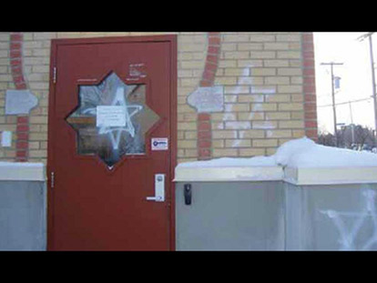 Graffiti on one of the entrances to the Outaouis Islamic Centre in Gatineau. The OIC was vandalised twice in three days in the first week of January.