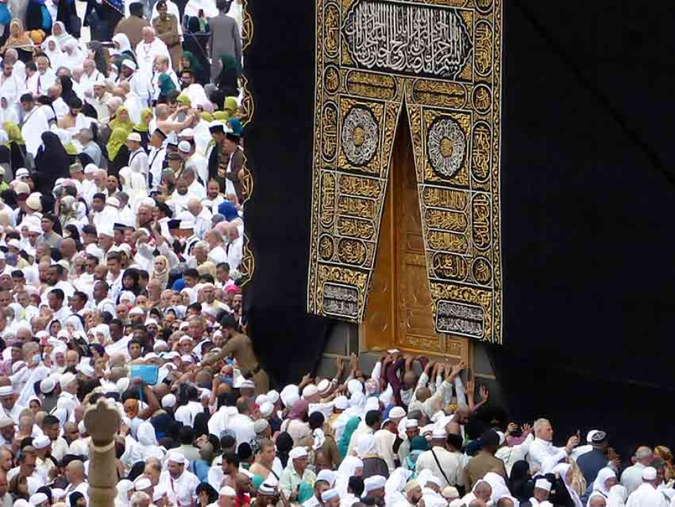 Umrah pilgrims pray near the Kaaba in Mecca, Saudi Arabia