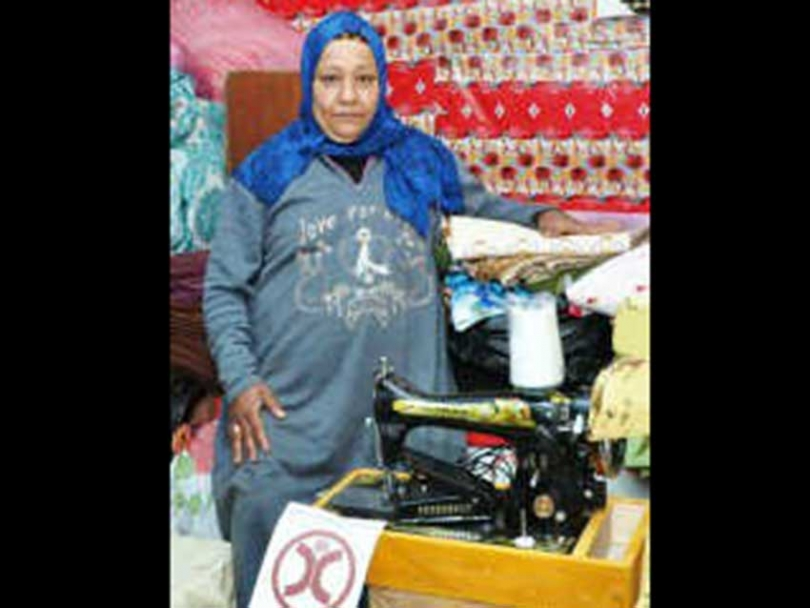 Nagah, 65, a beneficiary of Human Concern International's micro-financing programmes in Egypt. She and her daughter (who is in the final year of high school) previously lived on handouts from the local mosque. Today Nagah is the owner of a sewing business.