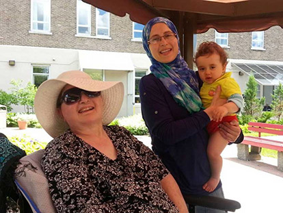 Amira Elghawaby with her mother Mona, and one of her children.