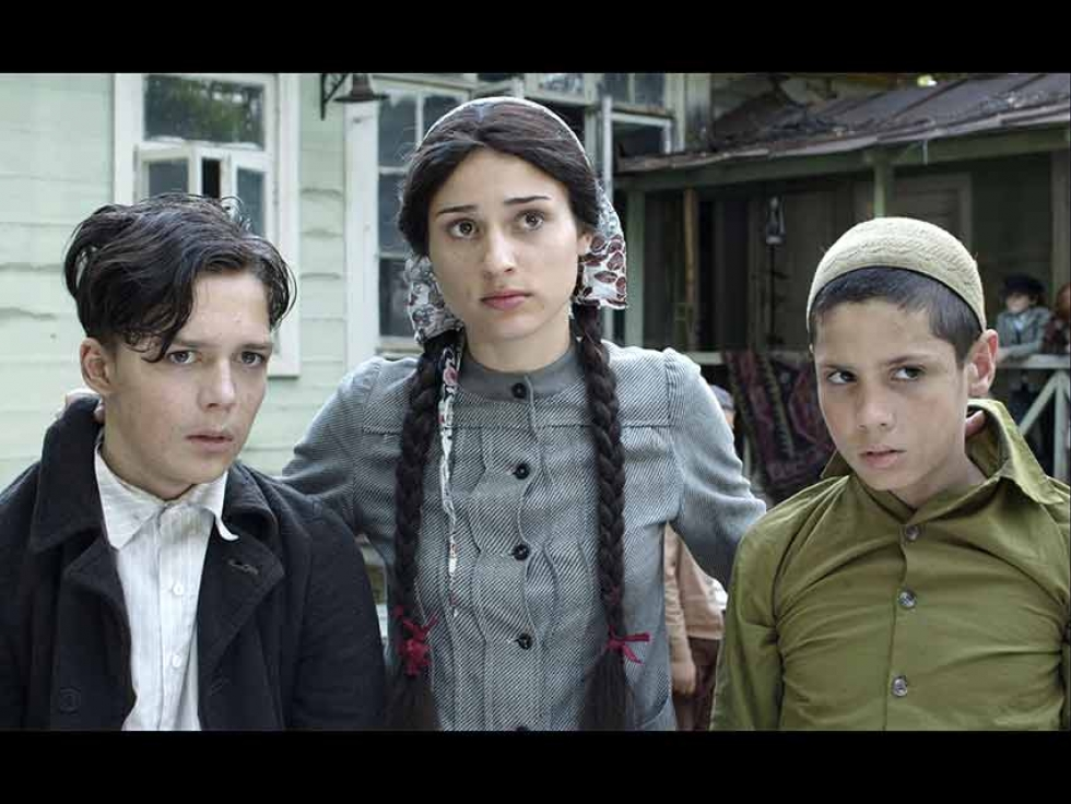 From the film: Saide Arifova with Itzhak, a Jewish orphan she is hiding, and Mustafa, a Tatar boy.