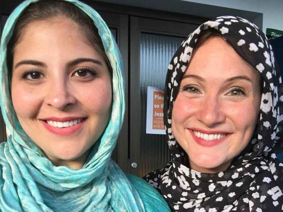 The author (right) with a friend, participating in a community iftar in Ottawa last year.