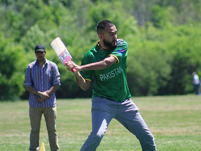 Abdullah Khan plays one of Pakistan's favourite sports at the Pakistani Students' Association's Summer Bash.