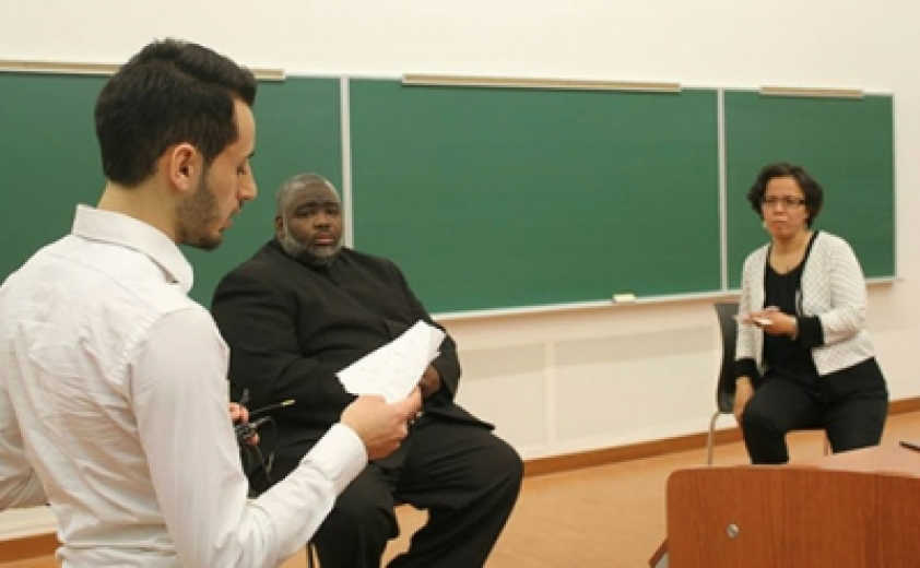 Mouhammed Hallawi, the president of ABSA at the University of Ottawa, moderates the Q & A session with Sheikh Hanif Mohamed and Reverend Bassma Jaballah