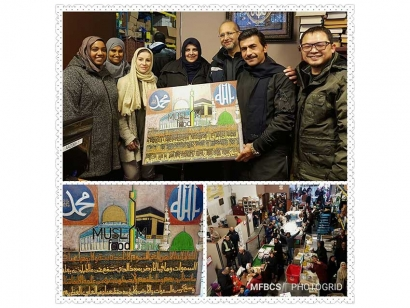 Muslim Food Bank & Community Services (MFB) staff and volunteers display a gift from a Syrian refugee artist in appreciation of the centre's work.