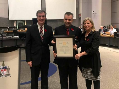 Mayor Jim Watson and Gloucester-South Nepean Ward Councillor Carol Anne Meehan presented the Mayor's City Builder Award to Dr. Mohd Jamal Alsharif.