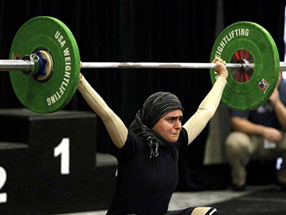 Muslimah weightlifter Kulsoom Abdullah at the USA National Weightlifting Championships last summer.