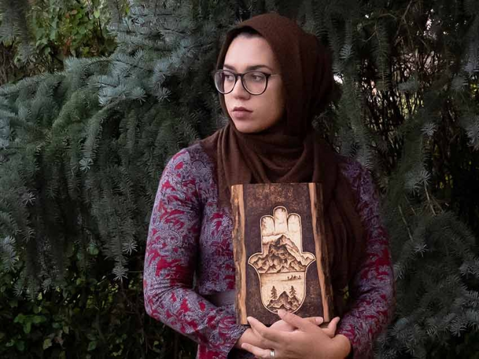 Calgary-based artist Aicha Lasfar explores the Canadian Wilderness through the artform of pyrography, the free-hand art of decorating wood using burn marks.