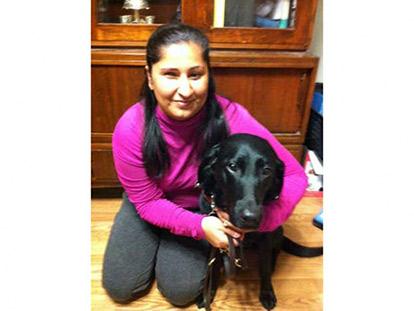 Arshina Kassam with her seeing-eye dog Kiki