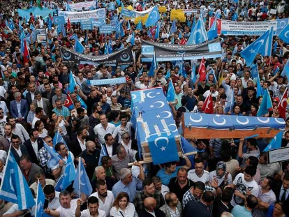 In this July 2015 photo, Uighurs living in Turkey and their supporters, some carrying coffins representing Uighurs who died in China's far-western Xinjiang Uighur region, chant slogans as they stage a protest in Istanbul, against what they call oppression by the Chinese government against Muslim Uighurs in the province.