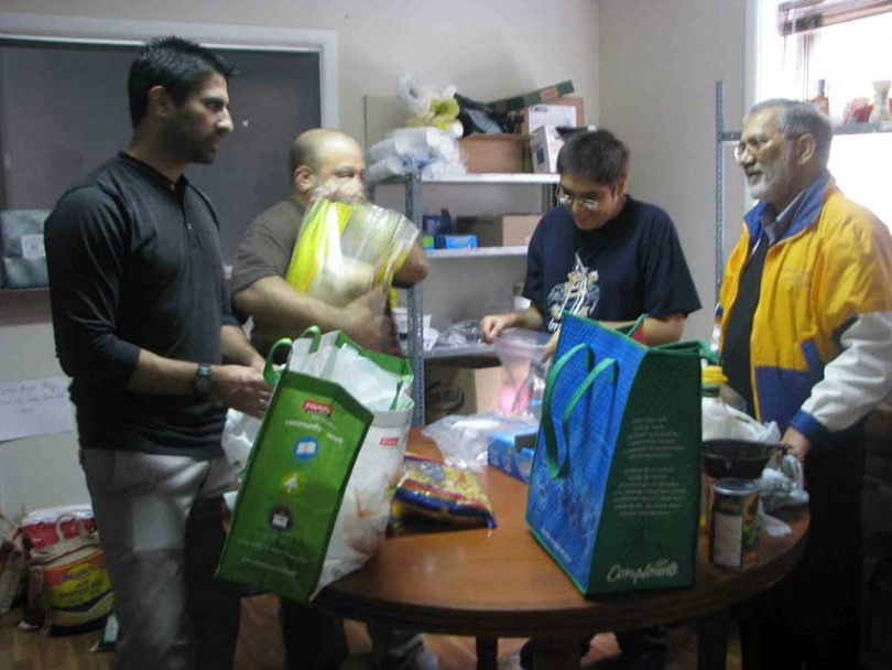 Sadaqa Food Bank volunteers sort food donations.