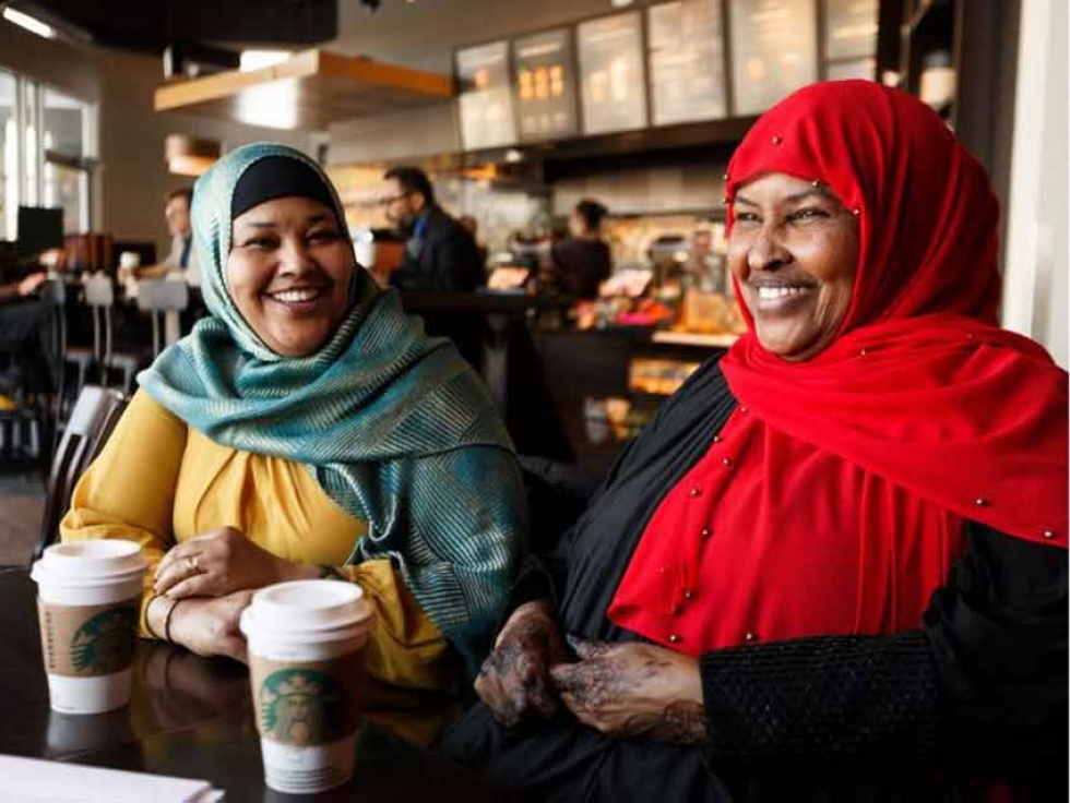 Amina Hussein, left, and Maryan Barrow in an interview at a coffee shop in Edmonton, on Friday, Feb. 8, 2019. The two mothers are part of a now year-old coalition of Somali mothers