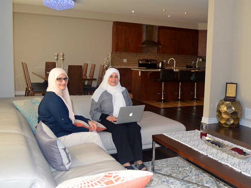 Sakna Bassam and her daughter in the family room of their Tartan home in Findlay Creek.