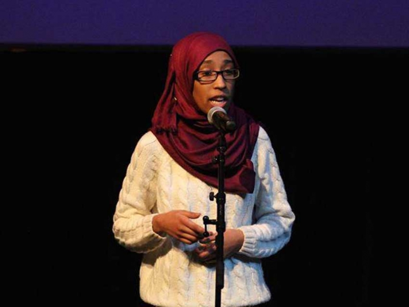 """Roua Aljied performing """"Looking Over Her Shoulder"""" at the Impact of Family Violence Conference in Ottawa."""