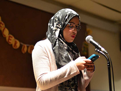 Hidayet Abbad performing her poem at Sanad Collective's Letters to the Beloved Awards Ceremony at the University of Ottawa