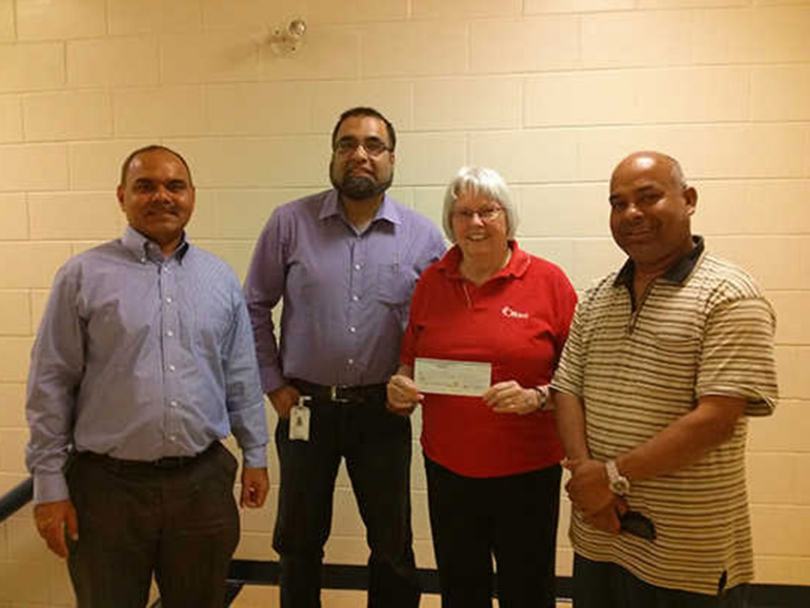 KMA Members presenting City Councillor Marianne Wilkinson with $2500 cheque